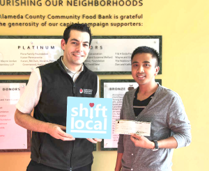 Michael Altfest of the Bay Area's Alameda County Community Food Bank accepting the donation from I LOB, LLC through Shift Local's Ideal Date Night contest